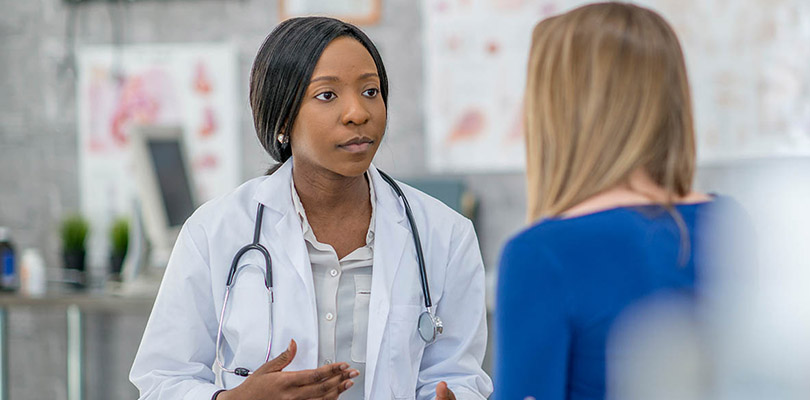 Female doctor talking to female patient