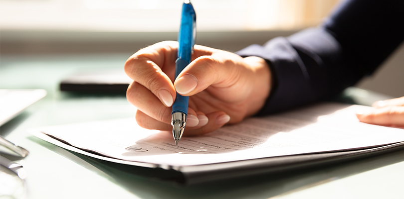 Woman filling out forms on a desk